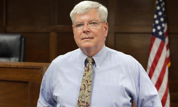 Syracuse Mediator James E. Reid